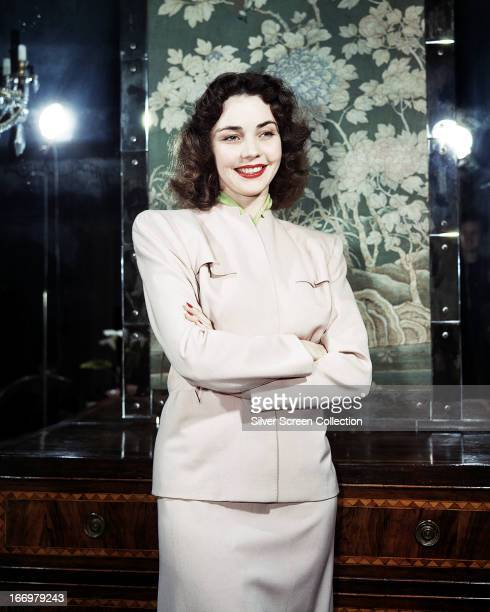 American actress Jennifer Jones wearing a white suit with padded shoulders circa 1945