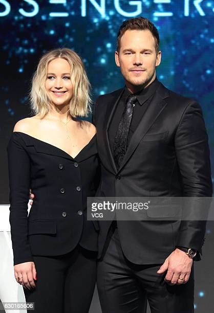 American actress Jennifer Lawrence and American actor Chris Pratt attend the press conference of director Morten Tyldum's film 'Passengers' on...