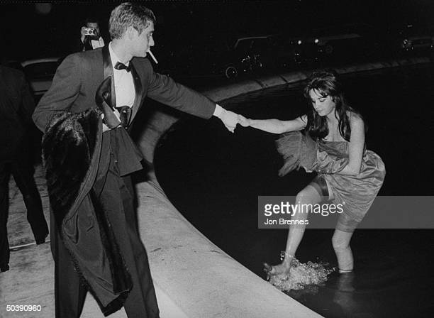 American actress Jeri Elam emerging from a fountain during the film festival