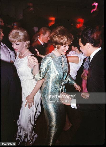 American actress Jill St John dance with an unidentified man at a nightclub 1964