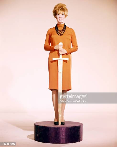 American actress Jill St John, poses with a sword on a stand, in imitation of an oscar statuette, circa 1965.