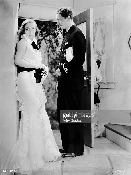 American actress Joan Crawford as Letty Lynton and Robert Montgomery as Hale Darrow in a scene from 'Letty Lynton' directed by Clarence Brown for MGM...