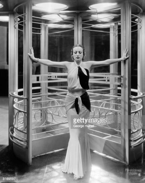 American actress Joan Crawford as she appeared in the title role of Clarence Brown's 'Letty Lynton', wearing an outfit by Adrian.