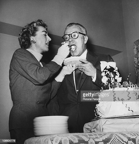 American actress Joan Crawford spoonfeeds cake to businessman Alfred Steele on their wedding day in Las Vegas 10th May 1955