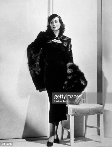 American actress Joan Crawford wearing a fur coat