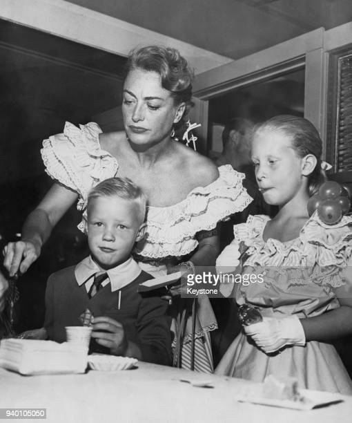 American actress Joan Crawford with her children Christopher and Christina circa 1947