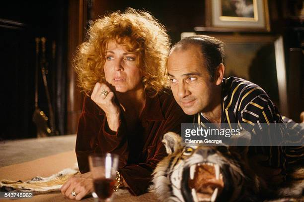 """American actress Joanna Cassidy with French actor Guy Marchand on the set of """"May Wine"""" , directed by Carol Wiseman."""