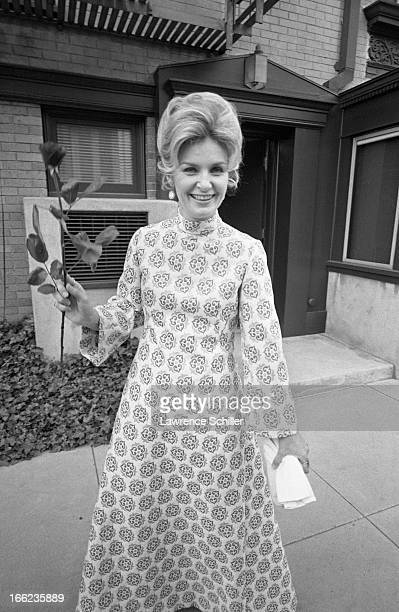 American actress Joanne Woodward poses with a rose as she prepares to attend the Academy Awards Los Angeles California April 7 1970