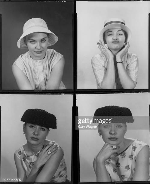 American actress Joanne Woodward tries on a variety of hats circa 1958