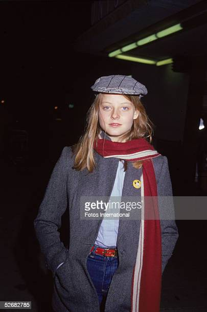 American actress Jodie Foster stands with her hands in her jacket pockets appearing at a Hollywood screening, January 1979.