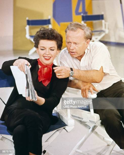 American actress Judy Garland shows a script to actor Mickey Rooney her guest star on an episode of 'The Judy Garland Show' as the pair rehearse...