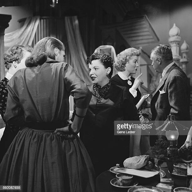 American actress Judy Garland talks to unidentified others at the 27th Academy Award nominations event Burbank California February 12 1955 Behind her...