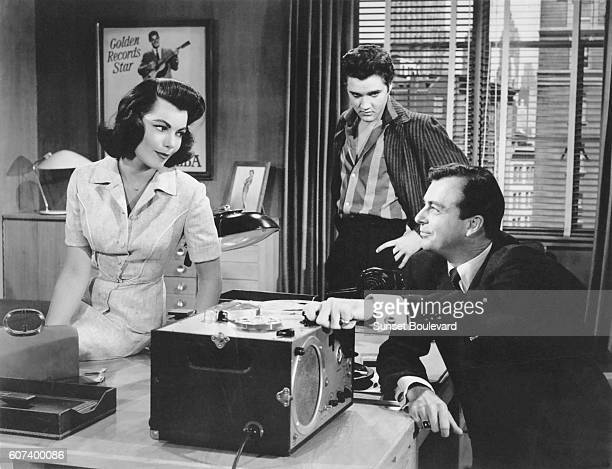 American actress Judy Tyler with singer and actor Elvis Presley on the set of Jailhouse Rock directed by Richard Thorpe