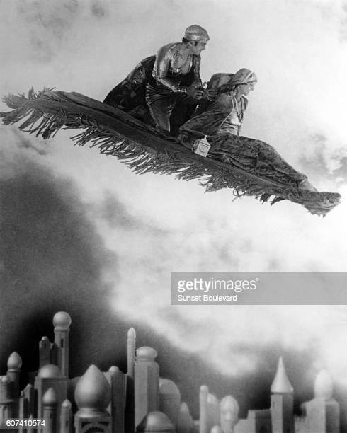 American actress Julanne Johnstone with actor screenwriter and producer Douglas Fairbanks Sr on the set of The Thief of Bagdad directed by Raoul Walsh
