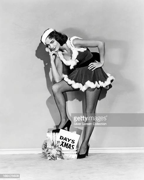 American actress Julie Adams poses for a Christmas portrait circa 1955