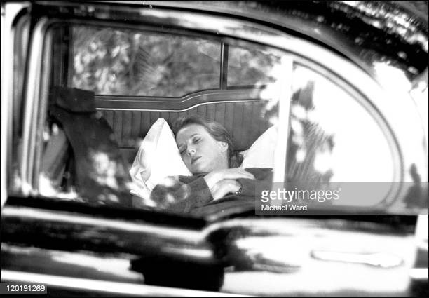 American actress Julie Harris asleep in the back of a car 1965