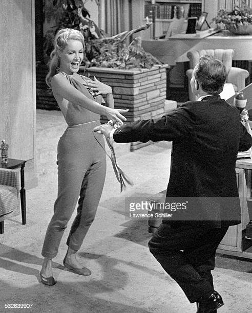 American actress Julie Newmar and British actor James Mason dance indoors in a scene from the film 'The MarriageGoRound' Los Angeles California 1960