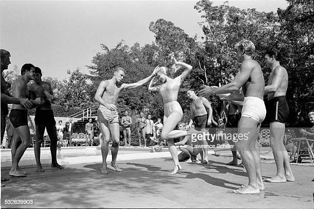 American actress Julie Newmar dances with various cast members in a scene from the film 'The MarriageGoRound' Los Angeles California 1960