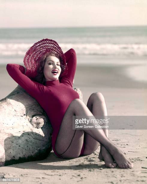 American actress Julie Newmar poses on the beach circa 1960