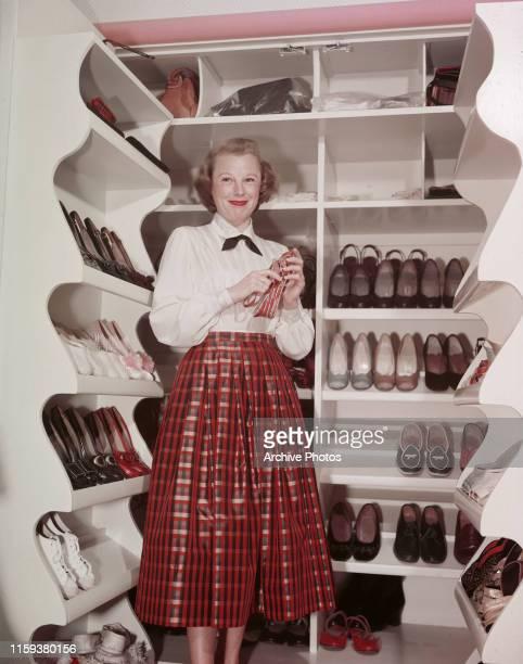 American actress June Allyson in her walkin shoe closet USA circa 1950