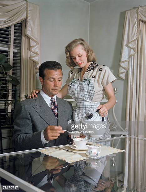 American actress June Allyson serves coffee to her husband actor and director Dick Powell circa 1947
