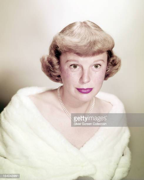 American actress June Allyson wearing a white fur stole circa 1950