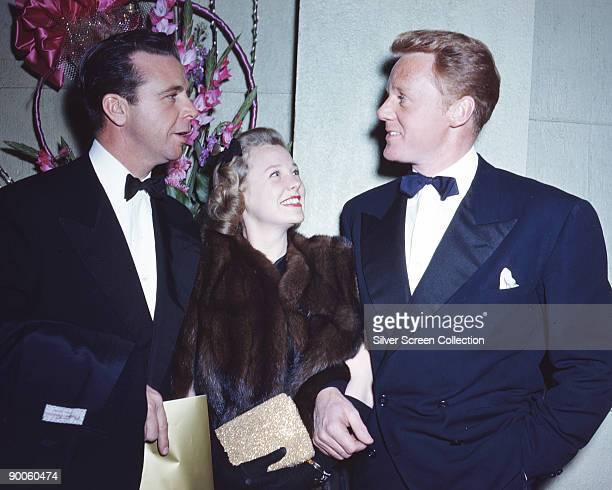 American actress June Allyson with her husband actor Dick Powell and another man circa 1950