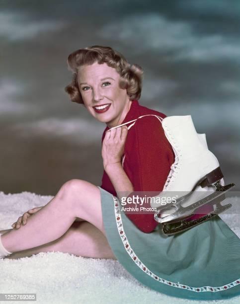American actress June Allyson with ice skates, circa 1955.