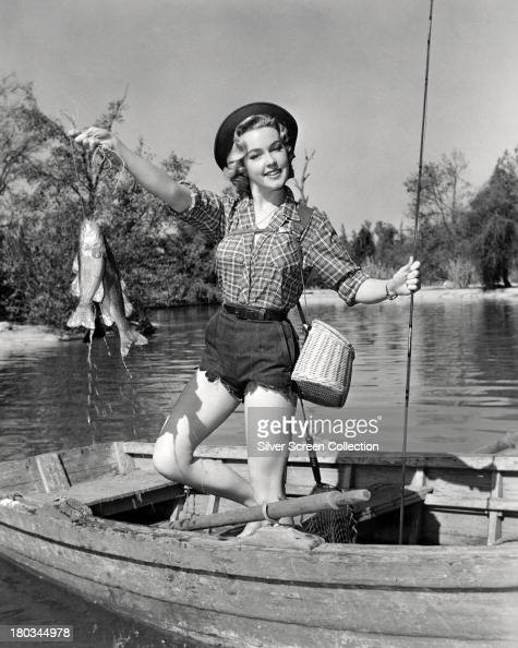 American Actress June Haver Poses Wearing Shorts And A