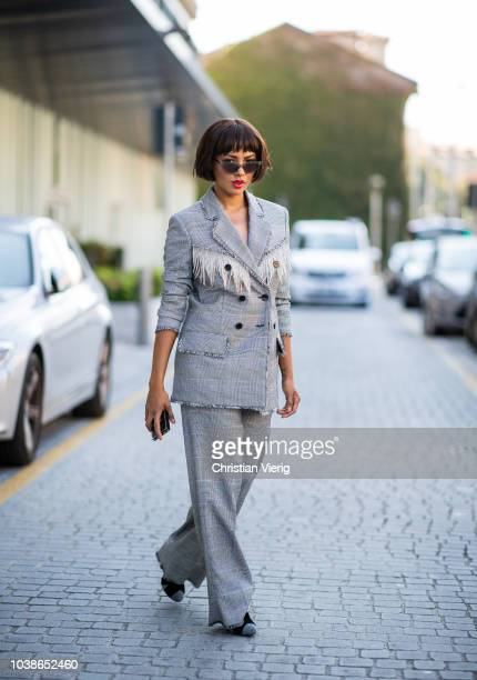 American actress Kat Graham is seen wearing grey checked suit MSGM during Milan Fashion Week Spring/Summer 2019 on September 23 2018 in Milan Italy