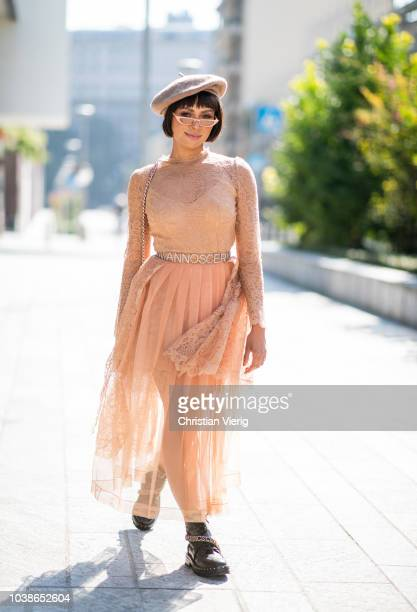 American actress Kat Graham is seen wearing pleated skirt hat boots bag and top Ermanno Scervino during Milan Fashion Week Spring/Summer 2019 on...