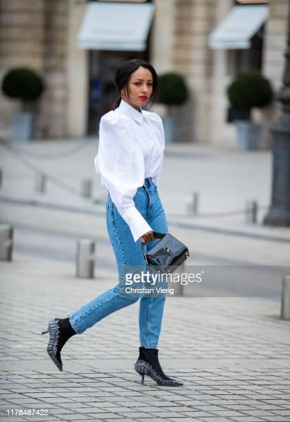 American actress Kat Graham is seen wearing Zara jeans white Khaite top midnight 00 shoes black bag during Paris Fashion Week Womenswear Spring...