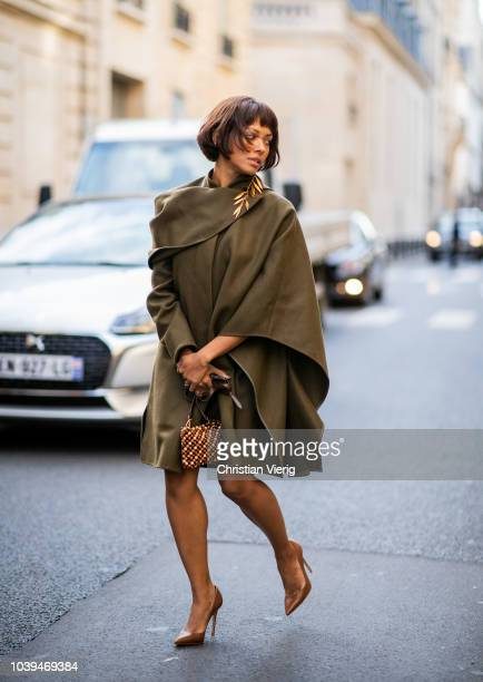American actress Kat Graham wearing olive Jacquemus jacket bag and golden earring and Gianvito Rossi shoes seen outside Jacquemus during Paris...
