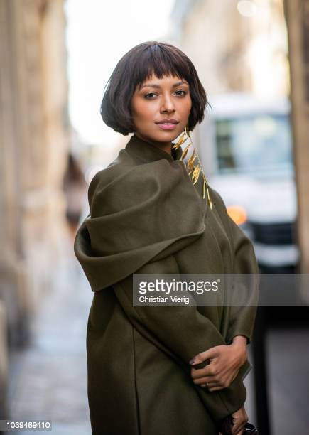 American actress Kat Graham wearing olive Jacquemus jacket, bag and golden earring and Gianvito Rossi shoes seen outside Jacquemus during Paris...