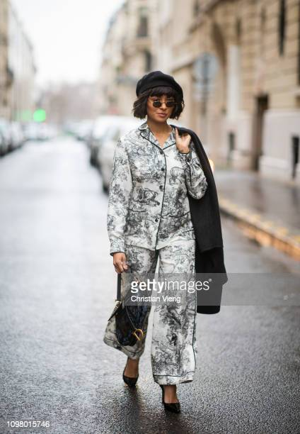 American actress Katharina 'Kat' Graham is seen wearing Dior suit with print beret bag and wool coat during Haute Couture Spring Summer 2019 Day Two...