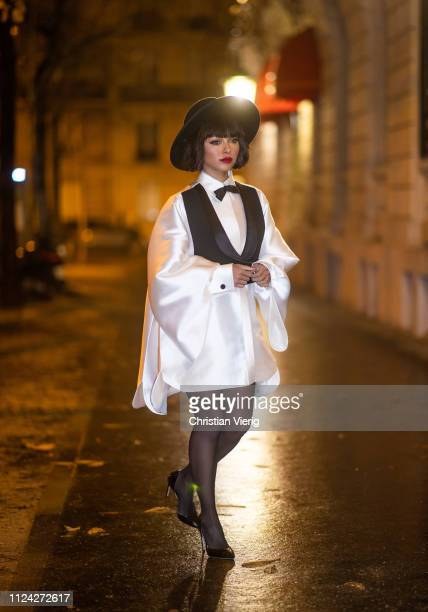 American actress Katharina 'Kat' Graham is seen wearing hat sheer tights white dress Jean Paul Gaultier during Paris Fashion Week Haute Couture...