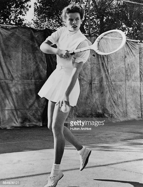 American actress Katharine Hepburn playing tennis circa 1935