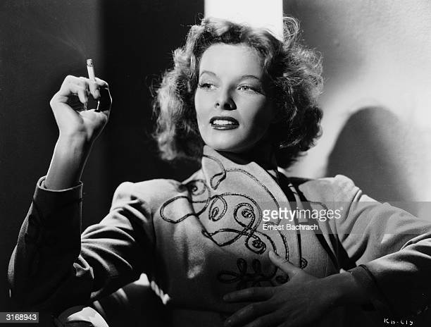 American actress Katharine Hepburn smoking a cigarette