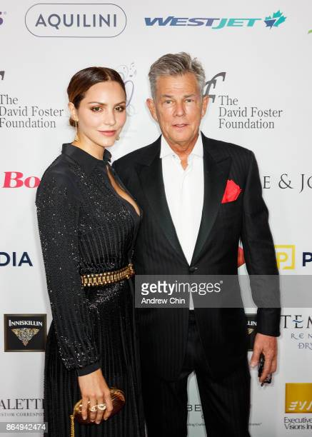 American actress Katharine McPhee and David Foster arrive for the David Foster Foundation Gala at Rogers Arena on October 21, 2017 in Vancouver,...