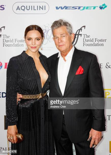 American actress Katharine McPhee and David Foster arrive for the David Foster Foundation Gala at Rogers Arena on October 21 2017 in Vancouver Canada