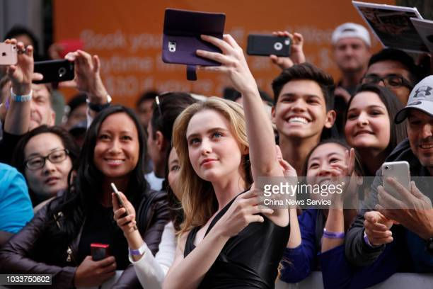 American actress Kathryn Newton takes a selfie during the premiere of film 'Ben is Back' during the 2018 Toronto International Film Festival on...