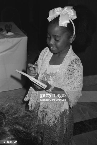 American actress Keshia Knight Pulliam signs autographs for fans circa 1985