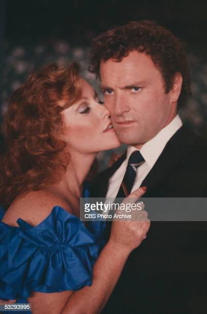 American actress Kim Lankford kisses Kevin Dobson during the episode 'Catharsis' of the CBS prime time soap opera 'Knot's Landing' October 28 1982