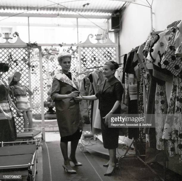 American actress Kim Novak posing beside Italian fashion designer Zoe Fontana - who founded the Sorelle Fontana fashion house together with her...