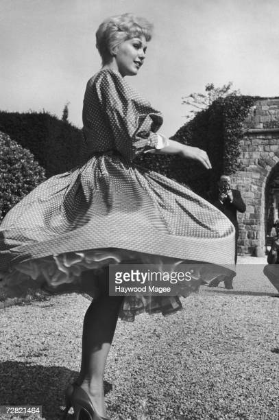American actress Kim Novak twirls for the camera at the Cannes Film Festival 2nd May 1956 Original Publication Picture Post 8418 What's The Angle On...