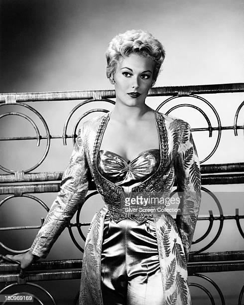 American actress Kim Novak wearing an exotic satin outfit circa 1955