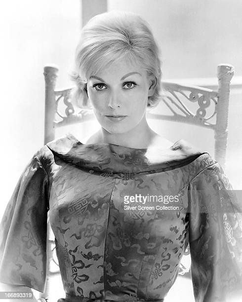 American actress Kim Novak wearing an oriental silk dress circa 1965