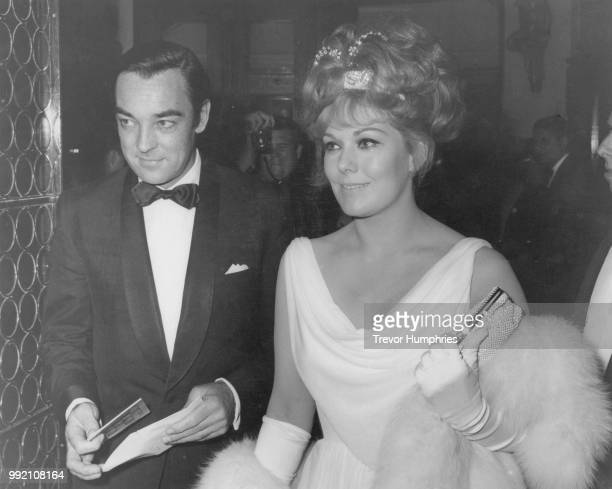 American actress Kim Novak with her fiancé British actor Richard Johnson at an event in London 1965