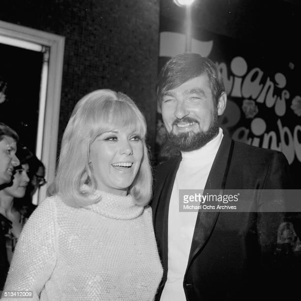 American actress Kim Novak with husband Richard Johnson at an event in Los Angeles, circa 1965.