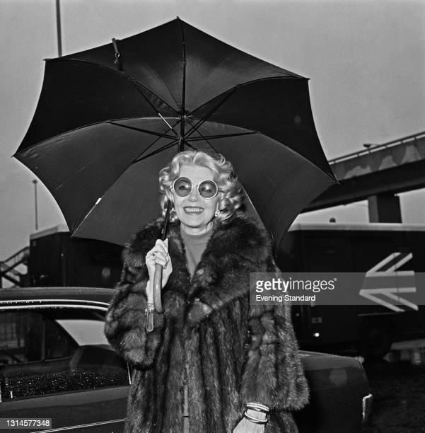 American actress Lana Turner at Heathrow Airport in London, UK, 16th October 1973.